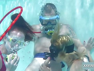 Babes take turns sucking dick undersea and they are so adventurous