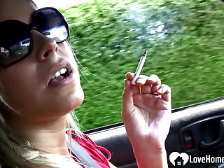 Saucy stepmom shows off feet while driving